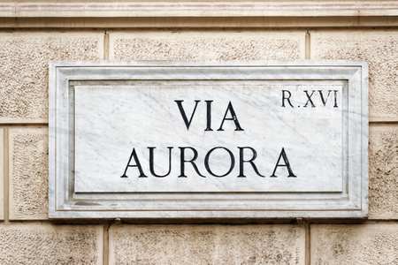 Via Aurora street sign on the wall in Rome, Italy