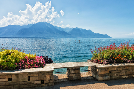 montreux: Bench and Plants blooming at the promenade of Geneva Lake in Montreux, Swiss Riviera