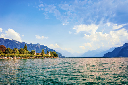Embankment of Geneva Lake in Vevey, Swiss Riviera. Alps mountains on the background