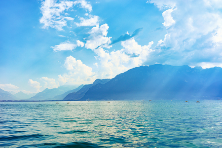 Nature of Geneva Lake in Vevey, Swiss Riviera. Alps mountains on the background