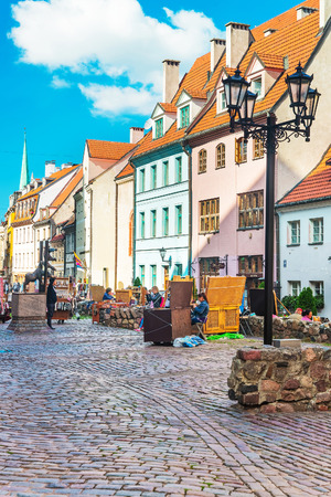 Riga, Latvia - September 3, 2014: Street market and people in the historical center in the old town in Riga, Latvia, Baltic country.