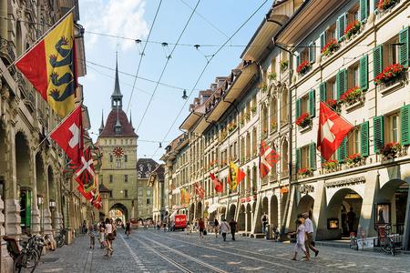 Bern, Switzerland - August 31, 2016: People on Marktgasse street with Kafigturm tower in Bern, Bern-Mittelland district, Switzerland