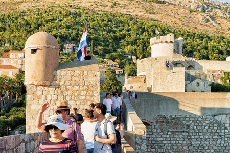 ragusa: Dubrovnik, Croatia - August 19, 2016: Fort Minceta and people on the Old City Walls in the Old town of Dubrovnik, Croatia.