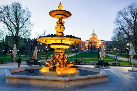 Boston, USA - April 28, 2015: Fountain at Boston Common public park and people in Boston, MA, America. At night