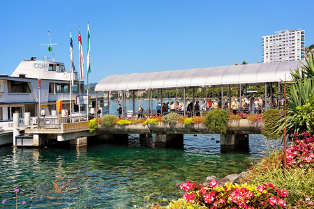 montreux: Montreux, Switzerland - August 27, 2016: Excursion ship and people on the pier on Geneva Lake in Montreux, Swiss Riviera Editorial