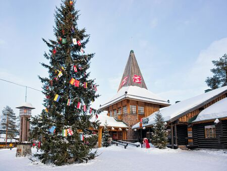street lamp: Rovaniemi, Finland - March 5, 2017: People at Santa Claus Office in Santa Claus Village with Christmas trees in Lapland, Finland, Scandinavia, on Arctic Circle in winter. Editorial
