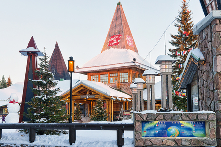 Rovaniemi, Finland - March 5, 2017: Santa Claus Office in Santa Village with Christmas trees in Lapland of Finland, Scandinavia, on Arctic Circle in winter. People on the background Editorial