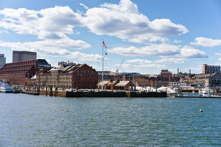 Customhouse at Boston Wharf across Charles river with the skyline of the city in the background in Boston, America Stock Photo