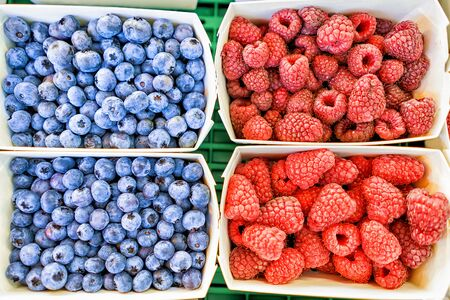 Closeup of fresh raspberry and blueberry in boxes