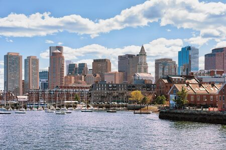 Water transport traveling across Charles river with the skyline of the city in the background in Boston, America