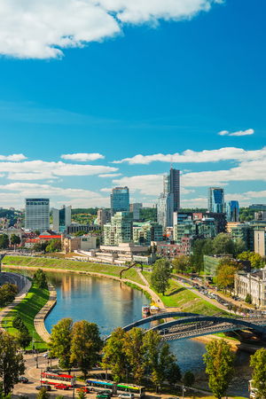 Bridge over Neris River and Financial district with skyscrapers, Vilnius, Lithuania, Baltic country.