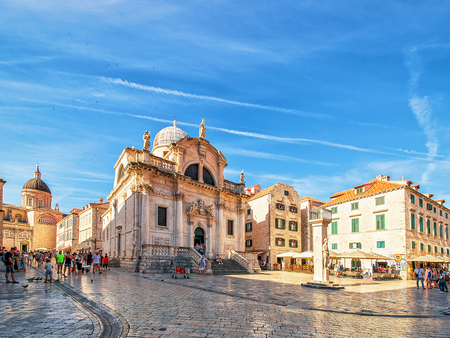 ragusa: Dubrovnik, Croatia - August 20, 2016: Square at St Blaise Church and people in Stradun Street in the Old city of Dubrovnik, Croatia