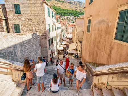 ragusa: Dubrovnik, Croatia - August 20, 2016: People sitting at Spanish Steps in the Old city of Dubrovnik, Croatia. Editorial