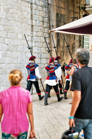 Dubrovnik, Croatia - August 18, 2016:  Change guards ceremony at the entrance gate in the Old city of Dubrovnik, Croatia. Selective focus Editorial