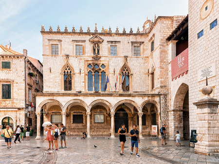 Dubrovnik, Croatia - August 20, 2016: People at Sponza Palace at Stradun Street in the Old city of Dubrovnik, Croatia.