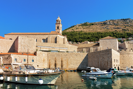 Sailing boats in the Old port in the Adriatic Sea in Dubrovnik, Croatia. People on the background Reklamní fotografie
