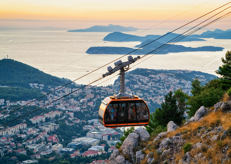 balkans: Cabin of cableway and ancient Dubrovnik at sunset, Croatia