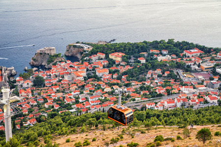 balkans: Cabin of cableway and ancient town Dubrovnik at sunset, Croatia