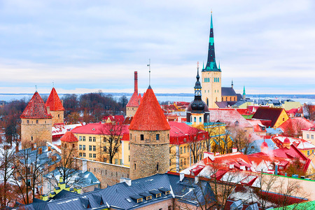 Cityscape with St Olaf Church and defensive towers at the Old town of Tallinn, Estonia in winter. View from Toompea hill Stock Photo