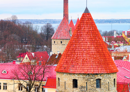 Cityscape and defensive towers of the Old town of Tallinn, Estonia in winter Editorial