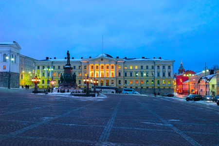 Statue of Alexander at Government Palace on Senate Square in the center of Helsinki, Finland in winter in the evening