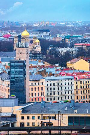 Riga, Latvia - December 29, 2016: Clock at Riga Town with Railway station in the evening, Latvia