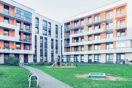 Vilnius, Lithuania - July 30, 2017: Complex of new apartment residential building with children playground as outdoor facilities. Editorial
