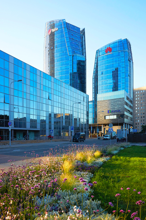 Vilnius, Lithuania - August 8, 2017: Huawei Technologies and Telia companies headquarter in the modern office building skyscraper in the business district on Europe Square, Vilnius, Lithuania. Editorial