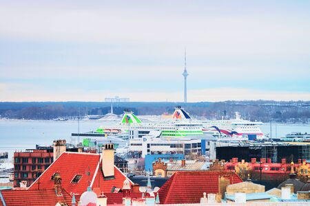 Tallinn, Estonia - February 27, 2017: Cityscape of the Old town, of Tallinn, Estonia in winter. Cruise liners in the port on the background