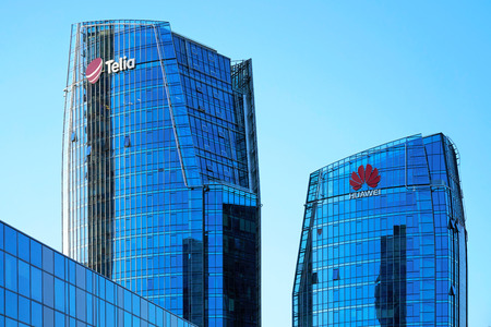 Vilnius, Lithuania - August 8, 2017: Huawei Technologies and Telia company headquarter in the modern office building skyscraper in the business district on Europe Square, Vilnius, Lithuania. Editorial