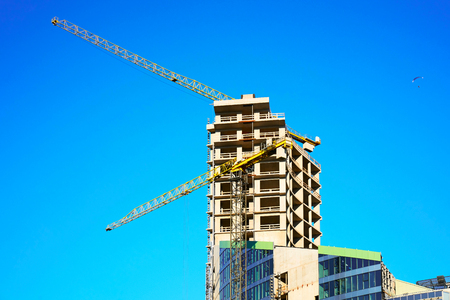 Development of commercial architecture of modern skyscraper. With lifting crane Stock Photo