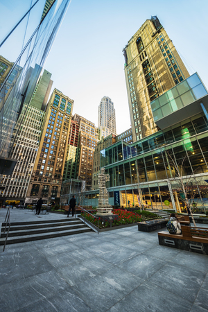 New York, USA - April 24, 2015: Small Public Garden at 120 West 42nd Street, between 6th and 7th avenue in Midtown Manhattan, New York City, NYC, USA. Tourists in the street