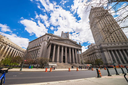 New York, USA - April 24, 2015: Street view on Thurgood Marshall United States Courthhouse and New York State Supreme Building, or New York County Courthouse, in Lower Manhattan, NYC. Tourists nearby.