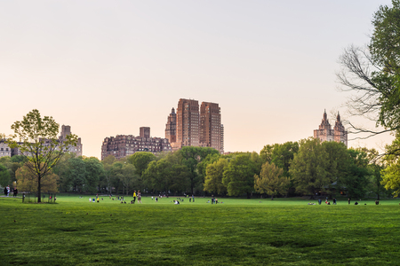 New York, USA - May 6, 2015: View on Uptown Manhattan skyline in Central Park West. On Upper West Side in New York, NYC, USA. People nearby
