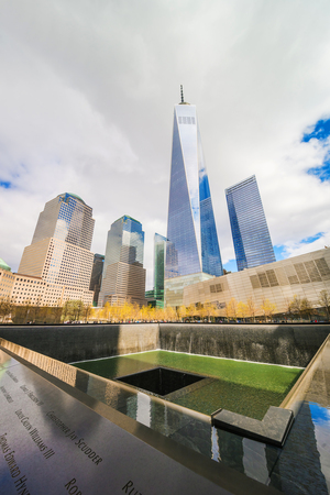 New York, USA - April, 24, 2015: Tourists and National September 11 Memorial - 911 - in Financial District in Lower Manhattan, New York City, NYC, USA.