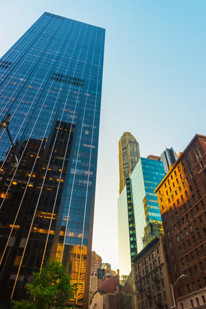 New York, USA - May 6, 2015: Bottom up view of Manhattan Skyscrapers. New York, NYC, USA. On sunny weather
