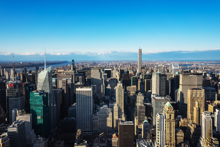 New York, USA - April 25, 2015: Aerial view from Observatory Deck of Empire State Building on Midtown Manhattan, New York, USA, at sunset. Hudson River and Jersey City, New Jersey, NYC, USA