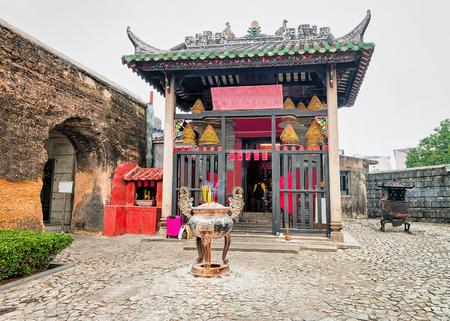 Na Tcha Temple in Historical old city center in Macao, China. People on the background