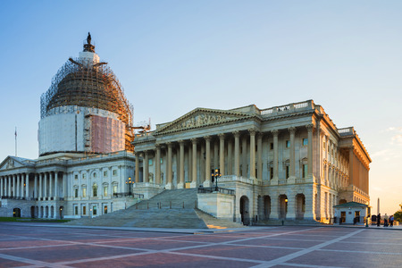 Washington DC, USA - May 3, 2015: United States Capitol locates on a top of a Capitol Hill in Washington. Architect of the building was William Thornton and building was completed in 1800 Editorial