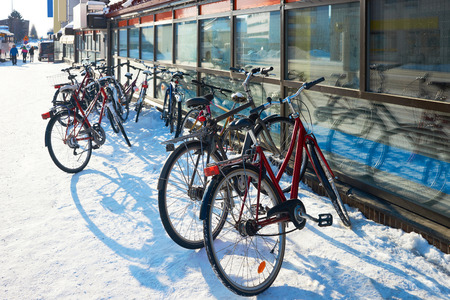 Bicycles in the snowy street in winter Rovaniemi, Lapland, Finland.