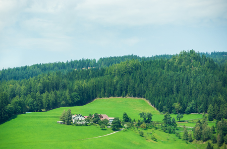 Village with houses in Alpine mountains in Austria, in summer. Stock Photo