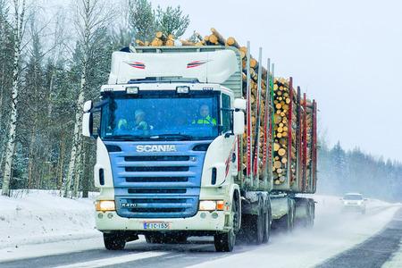 Rovaniemi, Finland - March 1, 2017: Wood cargo vessel in the road in Rovaniemi, winter  Lapland, Finland