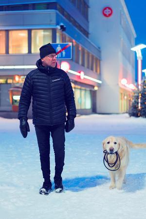 Rovaniemi, Finland - March 1, 2017: Man with Labrador dog in winter Rovaniemi, Finland. Editorial
