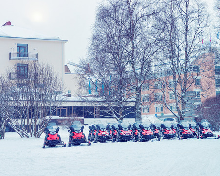 Snowmobiles in the street of winter Rovaniemi, Lapland, Finland