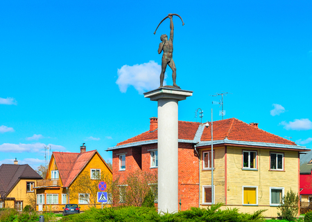 Archer sculpture at the crossroads with rotary motion in Druskininkai, Lithuania. Stock Photo