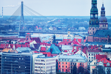 Riga Old Town with Vansu Bridge over Daugava River, Dome Cathedral and St Peter Church in winter