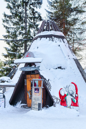 Rovaniemi, Finland - March 5, 2017: Suomi traditional house at Santa Claus Office, Santa Village in Finnish Lapland, Scandinavia, on Arctic Circle in winter. Outdoor