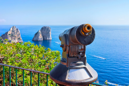 Telescope at Faraglioni in Tyrrhenian Sea on Capri Island, Italy Stock Photo