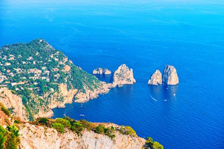 Faraglioni cliffs and Tyrrhenian Sea of Capri Island, Italy Stock Photo - 91518115