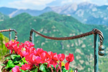 Flowers and view on mountain in Ravello village, Tyrrhenian sea, Amalfi coast, Italy